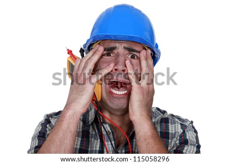 Electrician in pain after shock - stock photo