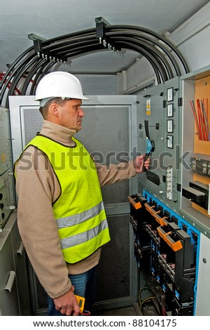 Electrician in studying the current-voltage switchgear and state electrical