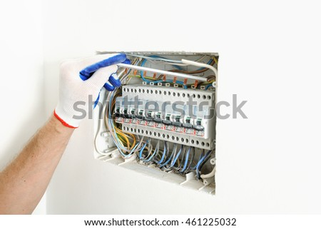 stock photo electrician installing an electrical fuse box in a house 461225032 electrician installing electrical fuse box house stock photo installing a fuse box at alyssarenee.co