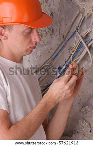 electrician insulating the electric wires - stock photo