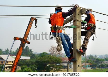 Electrician Lineman Repairman Worker At Climbing Work On Electric Post Power Pole Thai Language Same