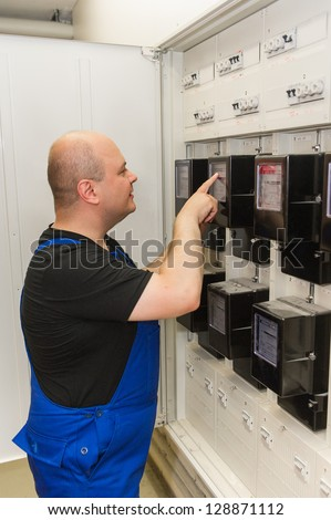 Electrician on cabinet