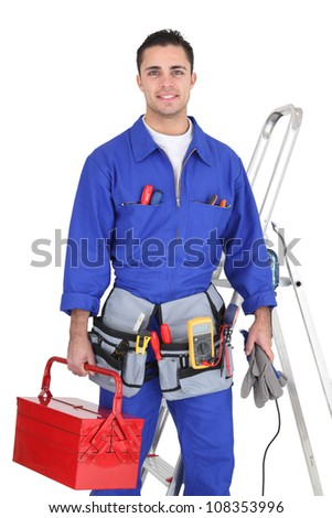 Electrician posing by his equipment - stock photo