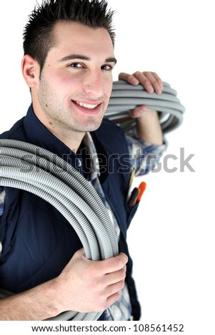 Electrician stood with corrugated cabling - stock photo