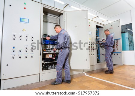 stock photo electrician testing industrial machine electrician builder engineer screwing equipment in fuse box 517957372 electrician testing industrial machine electrician builder stock industrial fuse box at cos-gaming.co