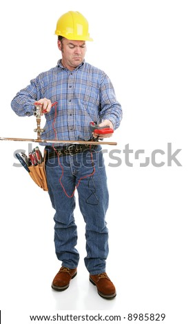 Electrician using a voltage meter on a copper plumbing pipe.  Full body isolated on white.