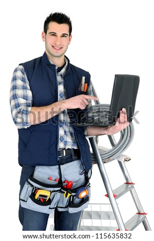 Electrician with laptop and ladder - stock photo