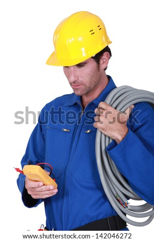 Electrician with voltmeter - stock photo