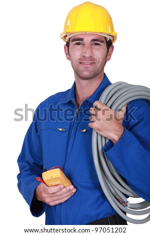 Electrician with voltmeter in hand - stock photo