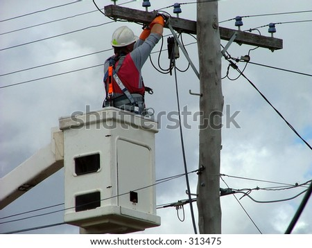 electrician working cherrie picker - stock photo