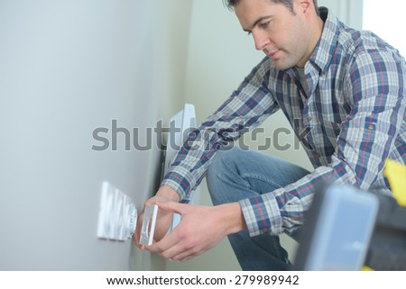 Electrician working on a new build - stock photo