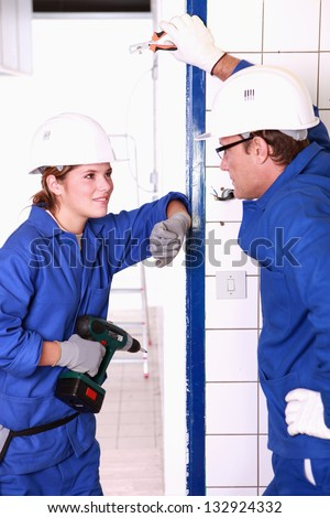 Electricians chatting on the job