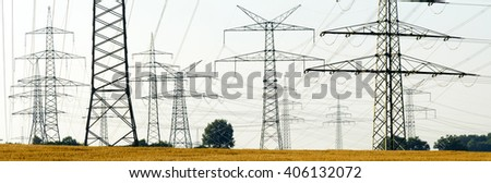 electricity and power poles in germany - stock photo