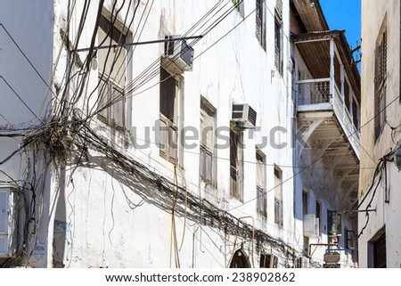 Electricity cable tangled in an old colonial street in Stone Town, Zanzibar - stock photo