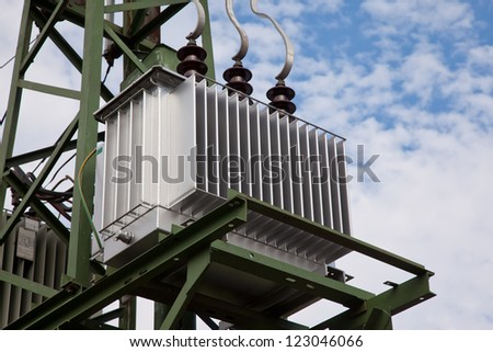Electricity distribution transformer with cooling ribs - stock photo