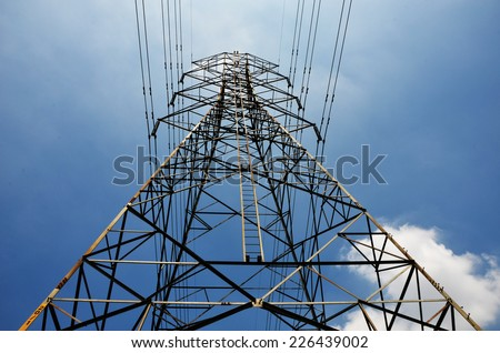 electricity high voltage pole and sky - stock photo
