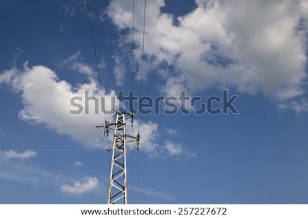 Electricity high voltage pole and the blue and cloudy sky