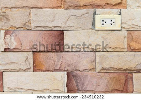 electricity outlet on brick wall - stock photo
