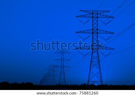 Electricity pillars against blue sky - stock photo