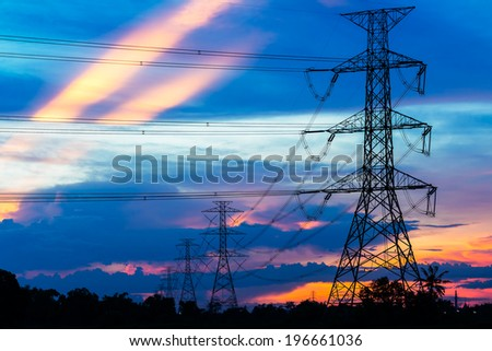 Electricity Pillars against colorful sunset  - stock photo