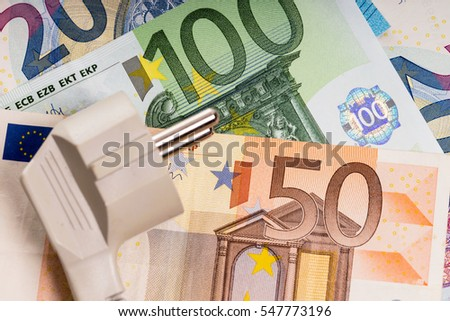 electricity plug and euro banknotes