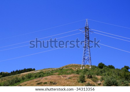 Electricity pole on high mountain - stock photo