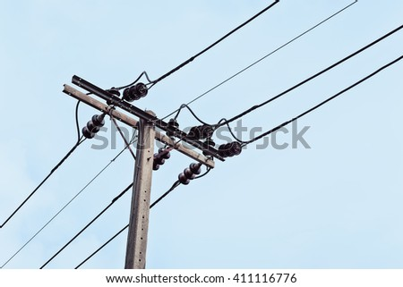 electricity pole on sky background