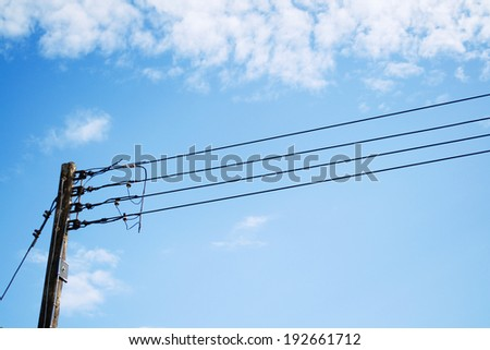 Electricity poles and wires with blue sky. - stock photo