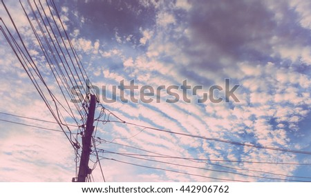Electricity post blue sky background and cloud vintage tone - stock photo