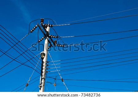electricity post in blue sky at Thailand - stock photo