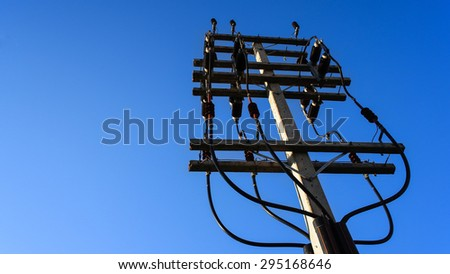 Electricity post on blue sky background
