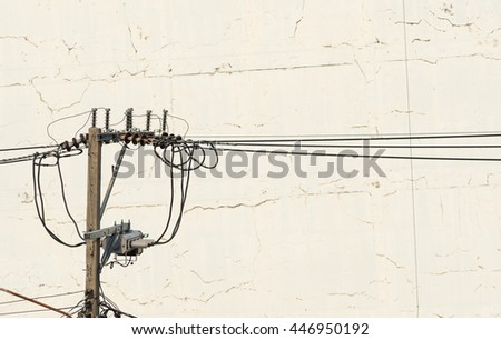 electricity post on plaster walls cracking background - stock photo