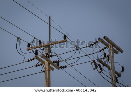electricity post with clear blue sky - stock photo
