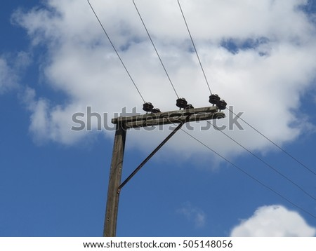electricity post with clear blue sky background