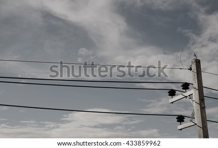 electricity post with cloudy and blue sky. black and white color. - stock photo