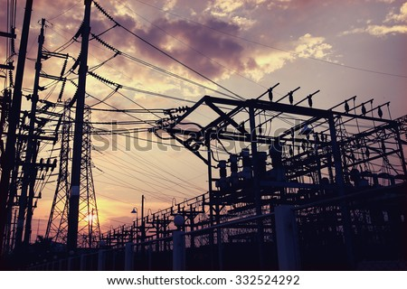 electricity power plant station silhouette with sunset light - stock photo