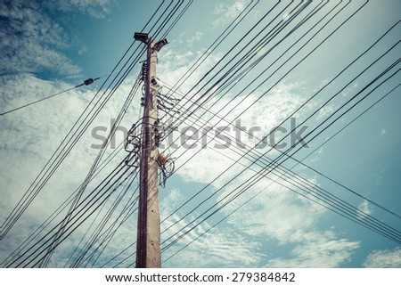 Electricity pylon and power-line with blue sky background, process color - stock photo