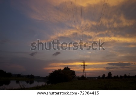 Electricity pylon at sunset in Lithuanian Village - stock photo