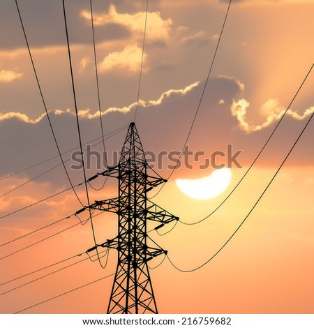 Electricity pylon isolated on sunrise background. - stock photo