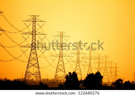 Electricity pylons and lines at sunset near Bangkok, Thailand - stock photo