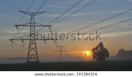 Electricity Pylons at dramatic sunrise and power plant Temelin - Czech Republic - stock photo
