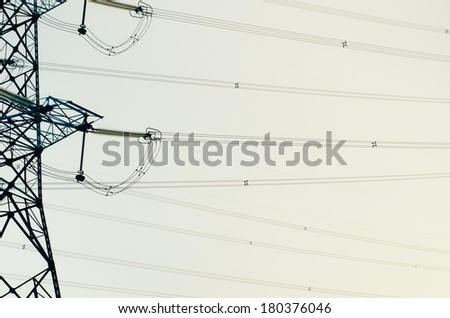 electricity pylons silhouette on the sky - stock photo