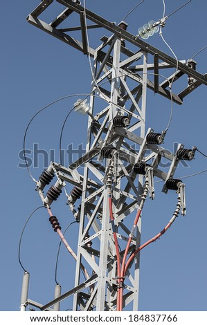Electricity pylons with high-voltage wires - stock photo