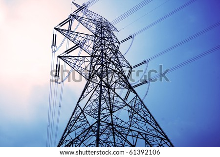 Electricity pylons with long cable at day - stock photo