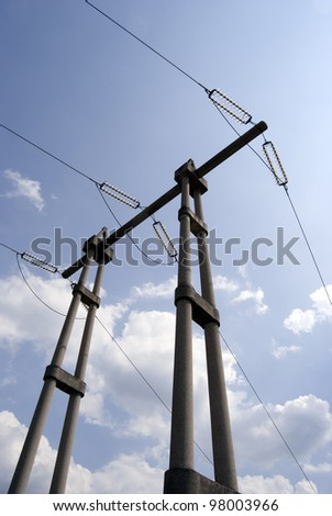 Electricity pylyn against blue cloudy sky - stock photo