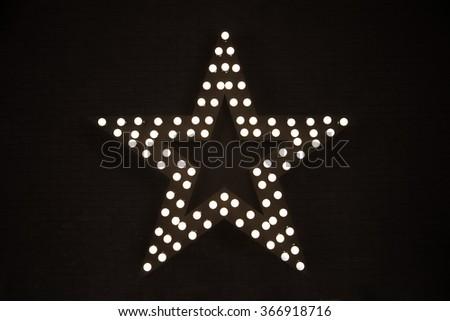 Electricity star, equipment. On dark brick background - stock photo