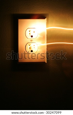 Electricity surging from an electrical socket