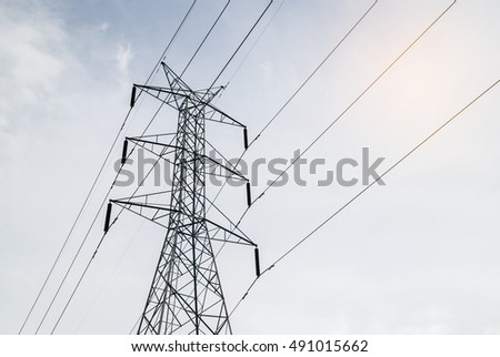 electricity transmission against blue sky background