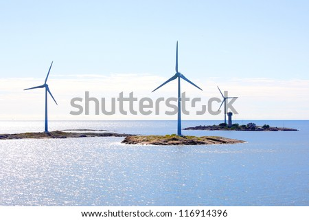 Electricity wind generators at Baltic Sea in Aland region. - stock photo