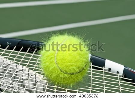 Electrified funny tennis ball on a racquet - stock photo